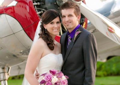 Groom and Bride in Front of Plane