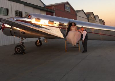 quinceanera unique event venue with airplane hanger getting off plane
