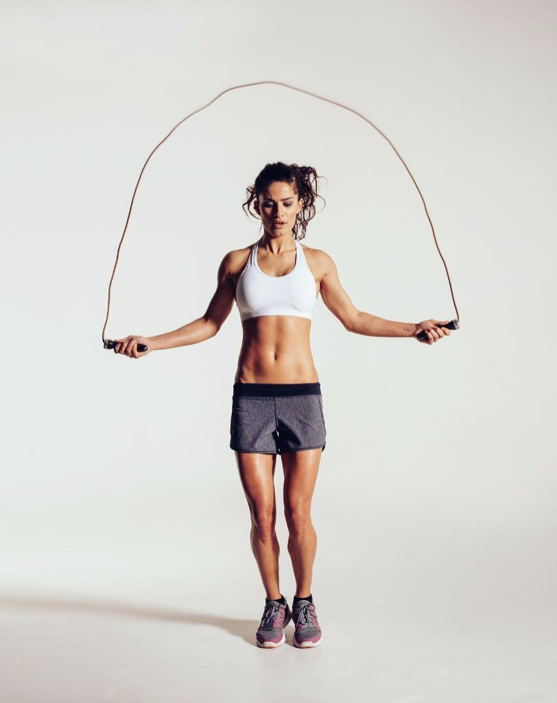 Fit Young Woman Skipping Rope