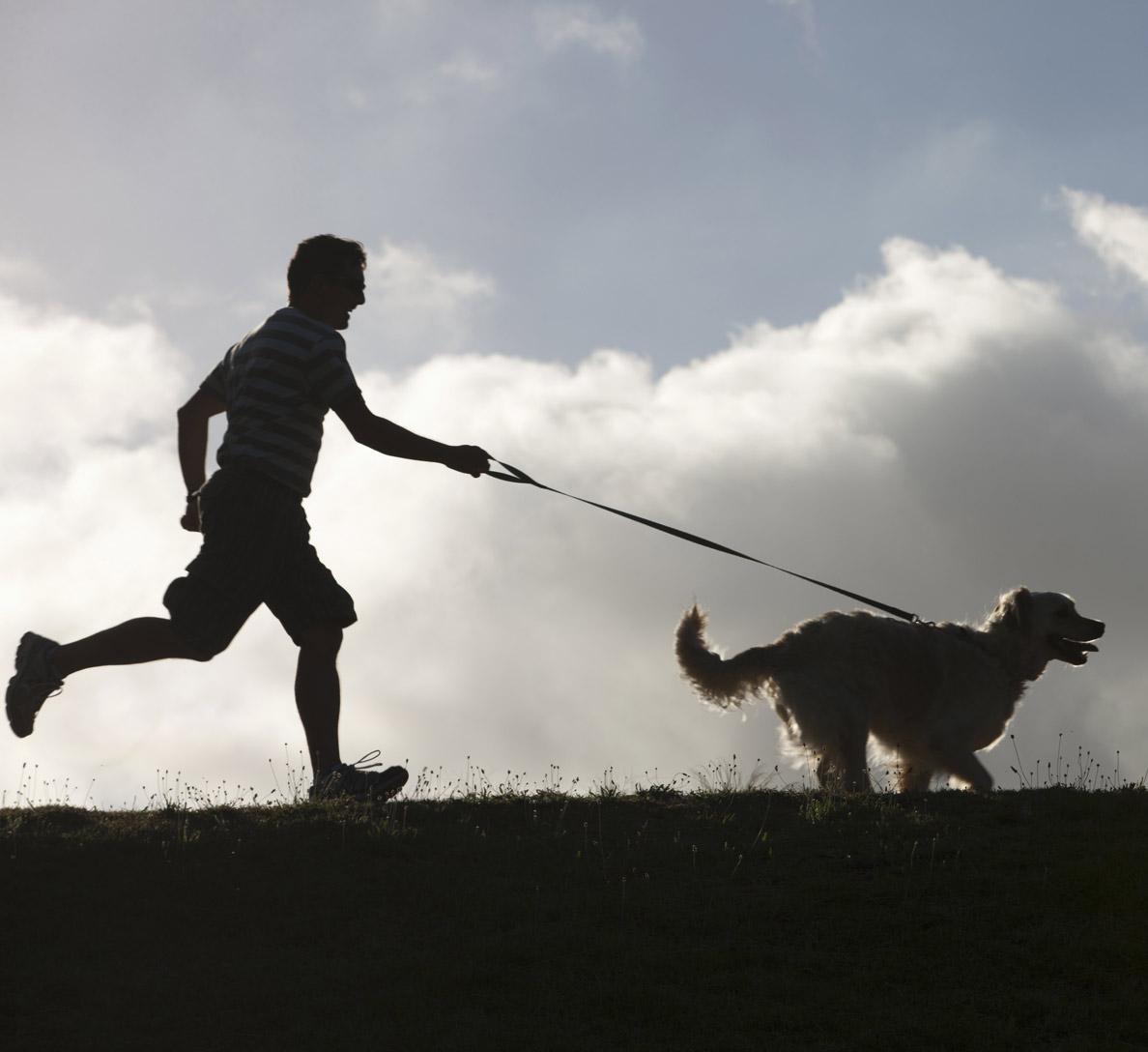 man-running-with-dog