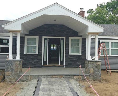 Front door of unique home with small porch area