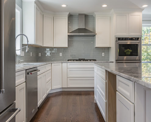 Kitchen with quartz countertops, stainless steel appliances and hardwood flooring