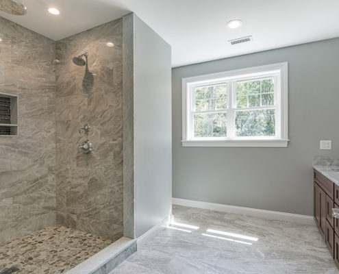 Custom bathroom with spacious built-in shower and countertop sinks