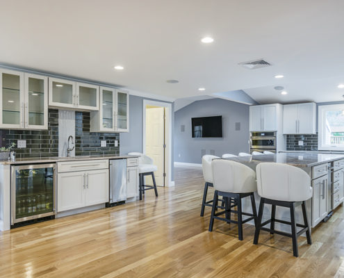 Hardwood floor kitchen with large middle island, plenty of seating and a custom designer feel