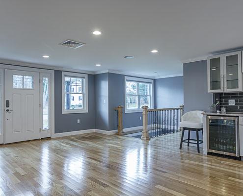 Entryway with Hardwood Floors and Mini Bar