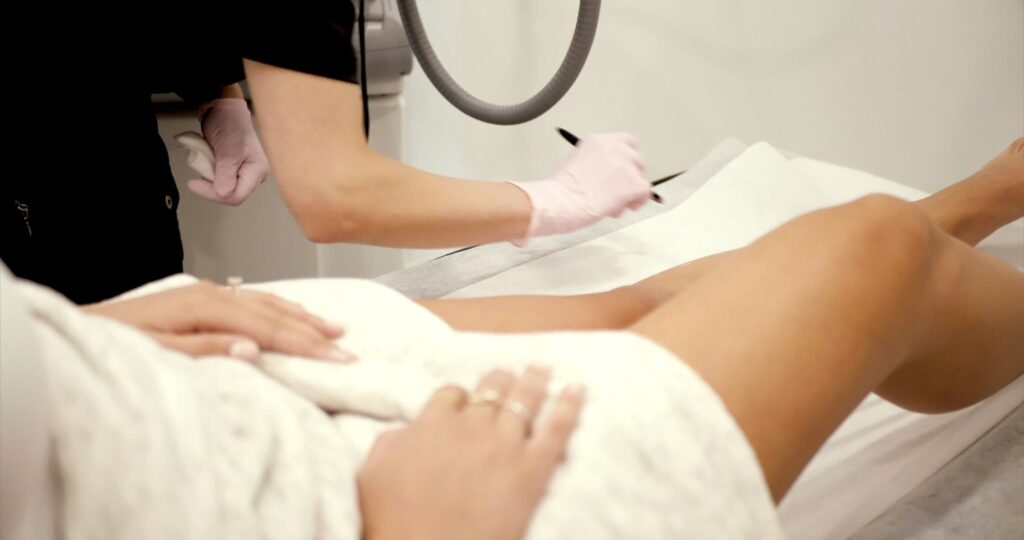 esthetician working on skin treatment beauty course online