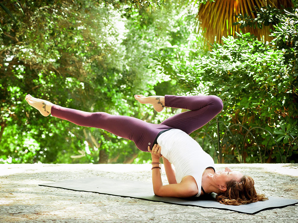 Jeanne Heileman is yoga pose for weekly Tantra Flow Yoga Class