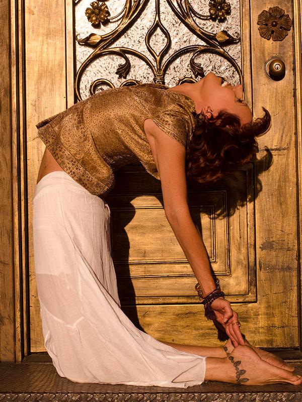 Yoga backbend in front of gold door