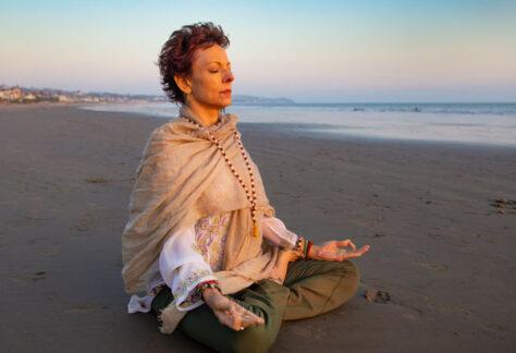 Jeanne on the beacjh in meditation understanding the Subtle Body