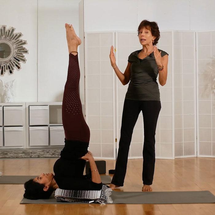 Jeanne teaching yoga poses