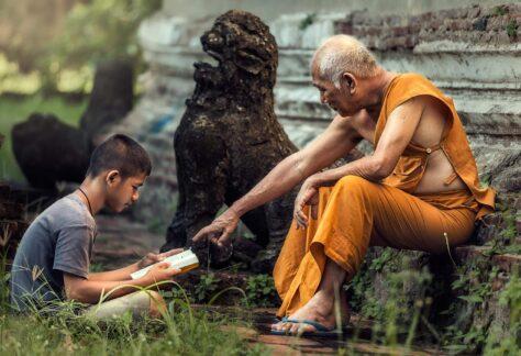 monk teaching boy