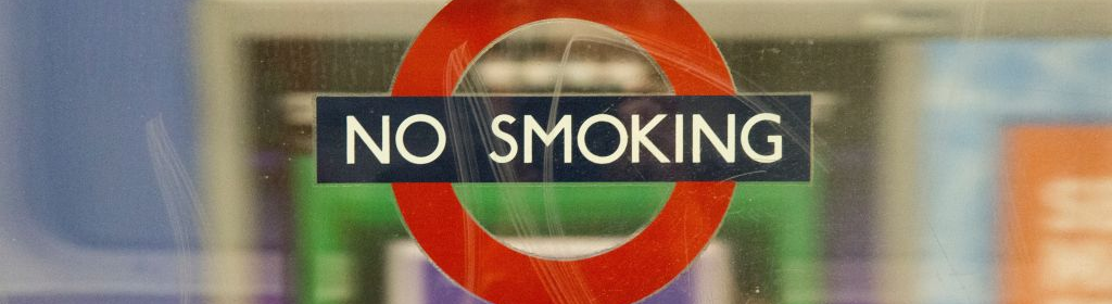 A metro sign saying no smoking.