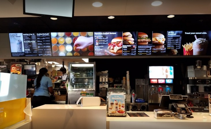Lenexa McDonald's fails inspection; stored as clear 15 plastic pans and lids with grease residue. Two plastic white pans with sticker residue