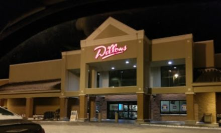 AFC Sushi in Dillon's in Manhatten bumbles inspection; food pans and one lid stacked and stored as clean with dried food debris on the food contact surfaces, 7 violations
