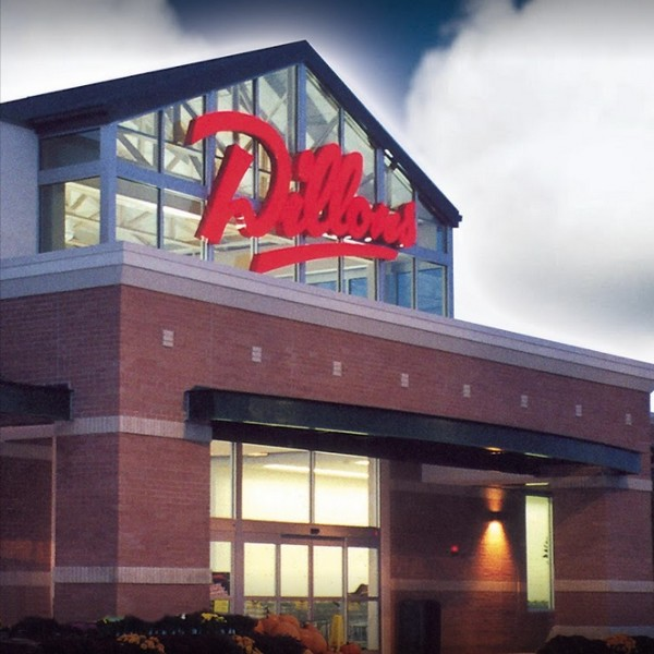 AFC Sushi inside Topeka Dillon's inspection; Employee washed hands at the deli hand sink without using soap, employee took thawed raw tuna from a package with gloved hands and touches cooked shrimp