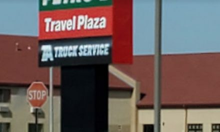 Inspection Oasis Travel Center;  bottle labeled red wine vinegar, employee throws it out- inspector believed substance to be QT sanitzer