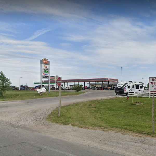 Phillips 66 Fuel Expresso 17 in Ottawa fouls inspection; approximately 20-30 house flies flying around the kitchen, and dining areas and landing on food, food counters, tables