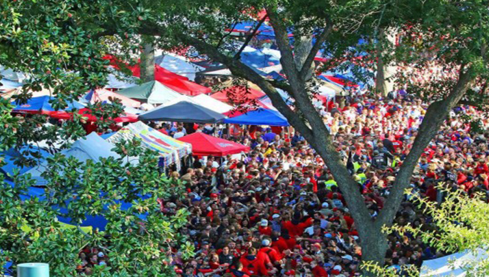 Tailgating at college campus before football game.