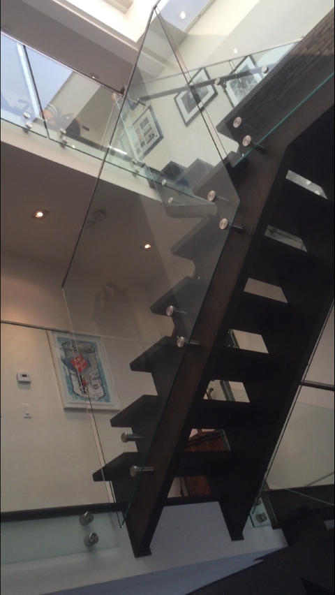 Staircase with glass partition
