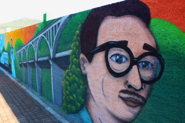 Grafite em muros de empresa conta a história e enaltece a cultura de Muçum
