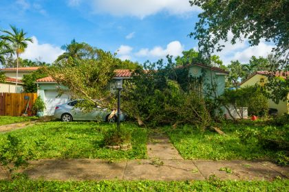 85962481 - miami, florida - september 11, 2017: debris filled front yard of a typical home as a result of hurricane irma in the neighborhood of west miami.