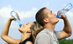 Are you dehydrated? Two people drinking water to stay hydrated