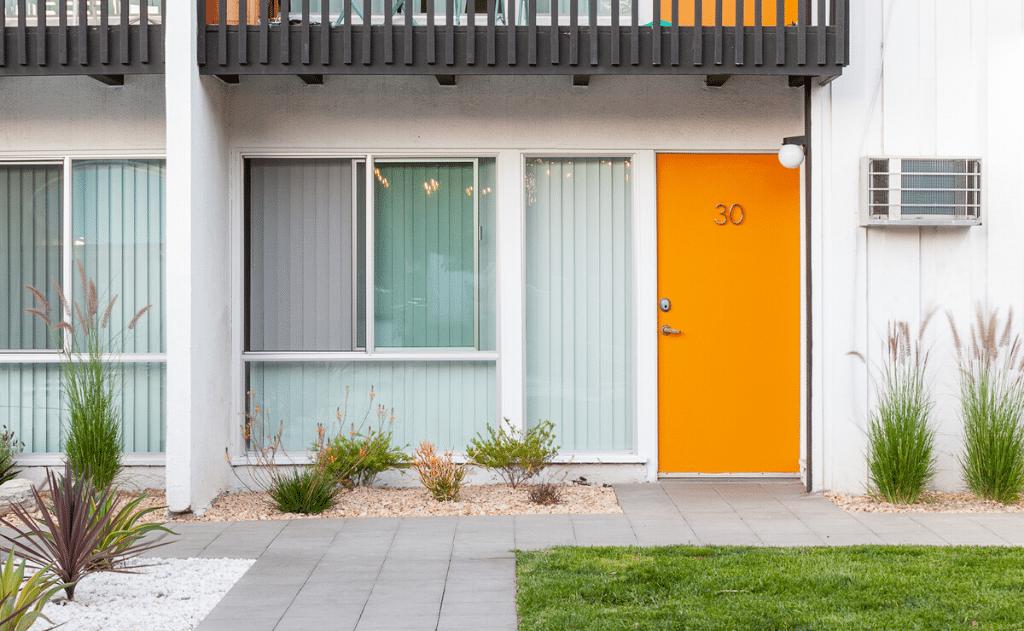 Apartment unit with orange door with sliding window