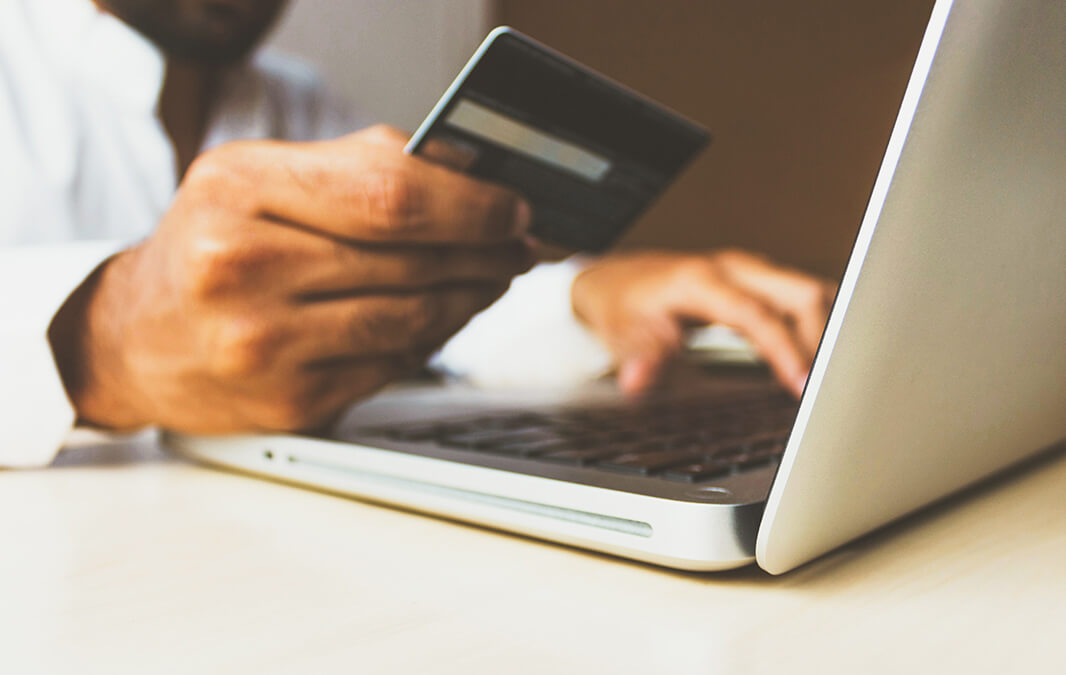 Person paying rent online with credit card