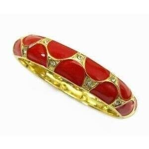 golden bracelet with large red circular inlays