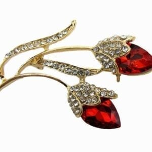 jewelry with deep red gem in a flower design