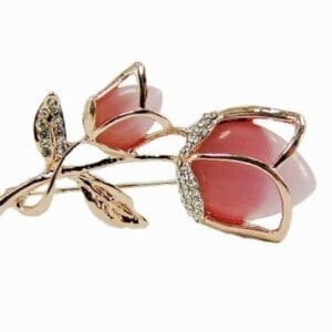 golden brooch with tulip design and pink stone inset