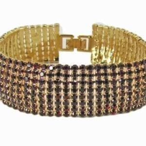 golden bangle with rows of dark gemstones