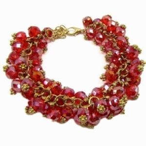bracelet with golden wires and clustered red gems