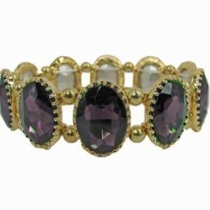 golden bracelet with oval, deep violet gems