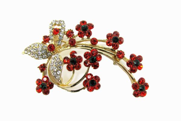 brooch with red and white crystals arranged like flowers