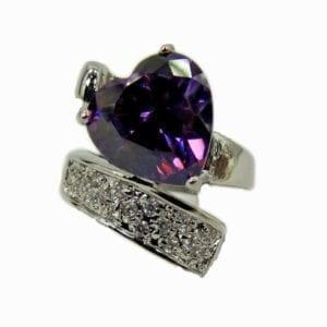 ring with violet heart gem