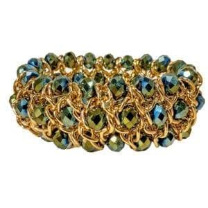 golden bracelet with blue and green gemstones