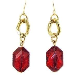 golden earrings with garnet gemstones