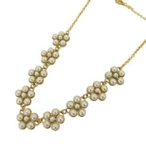 gold necklace with pearls arranged like flowers