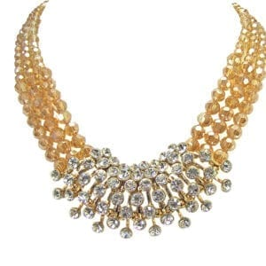 layered necklace with yellow beads and white crystals