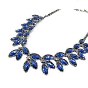 silver necklace with blue gems in a leaf design