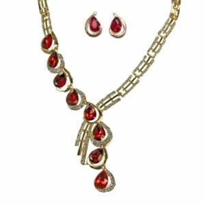 silver necklace with elaborate rows of ruby gems and gold designs