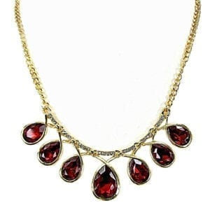 golden chain necklace with rows of teardrop ruby crystals