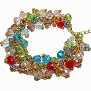 golden bracelet with clusters of multicolored crystals