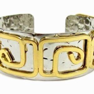 silver bracelet with golden geometric design