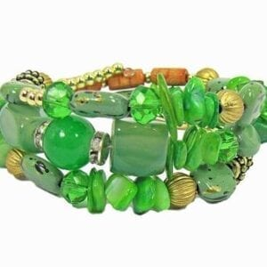 layered bracelet with green beads, stones, and crystals