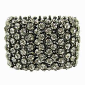 dark silver bangle with many tiny white crystals