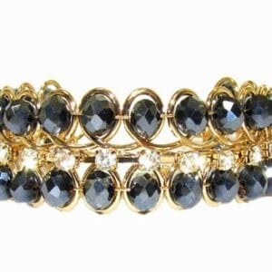 bracelet with gold wiring and black and white crystals