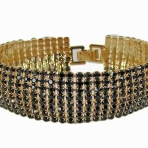 gold bangle with many tiny black crystals