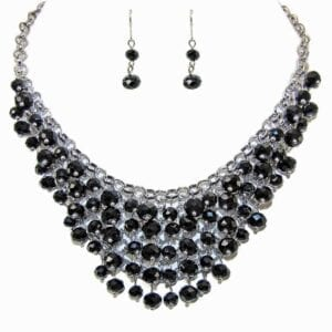 layered necklace and earrings with dark circular crystals